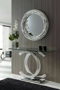 Inspiring mirror designs that will bring luxury to your home! These mirrors combined with a modern console table are the perfect combination. Hallway Decorating, Entryway Decor, Interior Decorating, Entryway Console, Interior Ideas, Living Room Designs, Living Room Decor, Decor Room, Modern Hallway