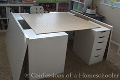home school ikea desk... confessions of a homeschooler... My school room is about 11′ x 14′, the total size of the desk is about 5′x5′. What are the specifics? 4 – Vika Alex Drawer units 2 – Vika Amon Table Tops (I purchased two 2.5′ x 5′ table tops and put them together for a 5×5 table) 1 Expedit Wall Shelf 4 Jules Jr. Swivel Chairs (Update: Swivel chairs are working well, they've gotten over the spinning, so it's all good now.) 5 DRÖNA Storage boxes