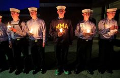 Maine Maritime Academy students attend a vigil of hope for the missing crew members of the U.S. container ship El Faro, Tuesday evening, Oct. 6, 2015, in Castine, Maine. The Coast Guard has concluded the vessel sank near the Bahamas during Hurricane Joaquin.