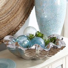 "Ceramic Silver Shell Bowl - $49.95  Pier One Handcrafted from heavy stoneware, each shell is plated with reflective silver metal,  17""W x 14""D x .50""H •Not for food use"