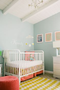 Nursery with coral, lemon and aqua. I like the idea of primary colors in different shades, so it's not as in your face