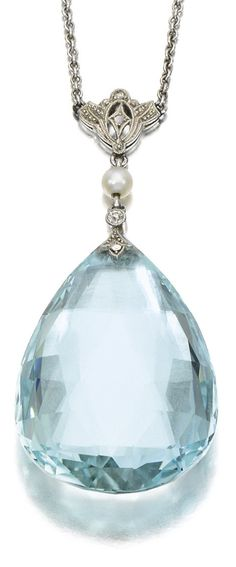 Art Deco or Edwardian aquamarine and diamond pendant, circa 1910-1920. It features a pear-shaped, faceted aquamarine drop suspended from circular-cut, rose diamond and pearl surmount on a curb link chain. 17 inch chain. Via Diamonds in the Library.