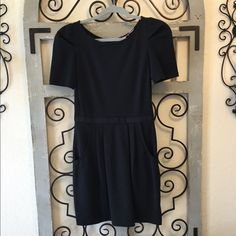 Juicy Couture dress Super cute and very flattering! I wore it once to a bridal shower and only for a few hours. No flaws Juicy Couture Dresses Midi