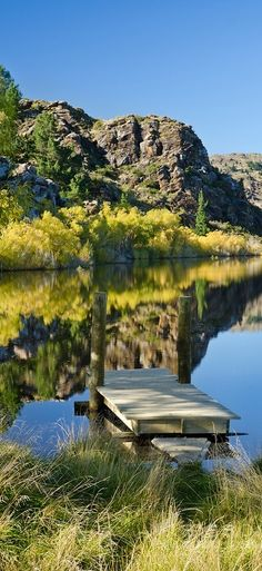 A calm Autumn day creates a perfect reflection in the water at Lower Manorburn Dam near Alexandra, Central Otago, South Island, New Zealand. Living In New Zealand, Visit New Zealand, New Zealand Travel, Nz South Island, New Zealand South Island, Central Otago, Tasmania, New Zealand Landscape, Australia Travel