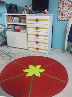 Sewing Room Pin Cushion Area Rug! LOVE!    Made from Red Duck Cloth, Green Grosgrain Ribbon -Kona Lime, Painter's drop cloth canvas, and Batting.