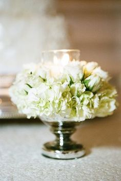 what about this as a center piece and then larger arrangements on tall stands situated throughout the hall?