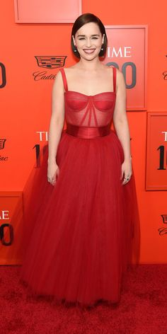 For the Time 100 Gala, Emilia Clarke looked absolutely beautiful in a red Dolce & Gabbana bustier gown with a glamorous tulle skirt.