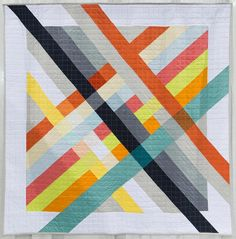 """#TBT to last February when Pique Nique by @the_milliner of the @mtlmqg was hanging  at #quiltcon. She says """"The Pique Nique quilt is inspired by visions of the ultimate picnic: brightly coloured ginghams and plaids and fresh hues borrowed from favourite foods  tomato orange sage zucchini maize and punchcheerful inspiration for a sunny bucolic setting amongst trees and open fields or a foggy day by the lake. Rotating the plaid weave adding neutral tones and playing with colour transparency…"""