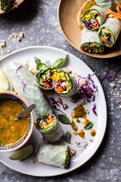 Avocado Veggie Spring Rolls - all packed with delicious good for you veggies and covered in the most amazing Thai mango dipping sauce. @halfbakedharvest.com