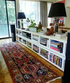 bookcase as room divider. Idea for daylight basement