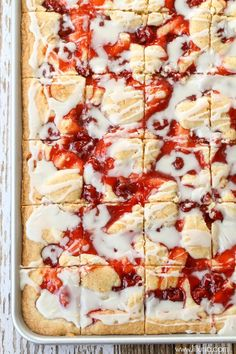 Delicious Cherry Bars topped with a heavenly glaze that has hints of almond extract. It will be your new favorite dessert! { lilluna.com }