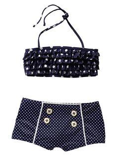 Cute little girl's polka dot retro swimsuit