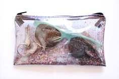 Small clear pouch with glitter   Handmade with clear plastic vinyl, glitter, plastic zipper. Dimensions: 11cm x 19cm (Approx 4.5 x 7.5)  *Colors may vary