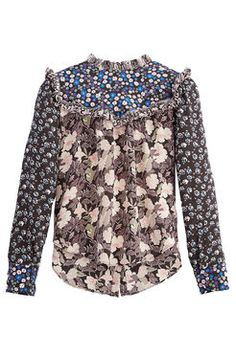 Patched Print Top This Victorian-inspired blouse is made in a modern mashup of brilliant printed silks finished with a high neck and pert ruffle details.