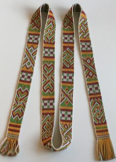 Tablet woven band in 4 colour float weave. Chelles style. Marijke van Epen. The Original band, showing eight different patterns, is re-used as a small cross on an alb in the st. Severin church in Cologne. Probably 7th century AD.
