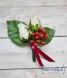 Ivory and cream rose boutonnieres with cranberries in different styles. Originally created for a groom and his groomsmen, each having a different style bout, you can choose to use all of the same, or mix it up a bit. All three bouts feature ivory or cream roses and cranberries.