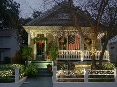 House decorated for Christmas with American Flag