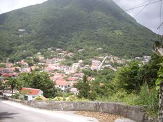 On Saba, all the houses look the same. Pretty white cottages with red roofs, green shutters and perhaps a small white gate. It's part of the island's charm and history.. Pretty as a postcard.http://waitingforaboattocome.com/2013/10/07/vlog-pretty-as-a-postcard/;# Saba, #expat's adventures in the Caribbean, # Dutch Caribbean#, #cottages in the Caribbean