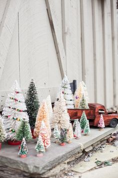 A Farmhouse Christmas - The Cottage Market - look at all the different colors, sizes and shapes of bottle brush trees.