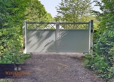 Aluminium Swing Gate New installation in Marlow, Buckinghamshire. RAL 9016 Aluminium swing gates hung from steel posts.