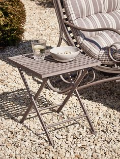 Crafted from strong, weighty metal with a vintage washed finish, our elegant side table has slim folding legs and a slatted square top. Our French inspired table has a rustic taupe finish and is the perfect companion for our Elegant Metal Lounger- Taupe. Easy to fold away when not in use, this small versatile table is part of our Elegant Metal Outdoor Furniture Collection.
