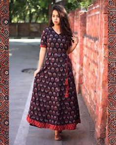 The Angrakha Demure Feel comfortably elegant in our all new Ajrakh print angrakha dress. Simple Kurta Designs, Kurta Designs Women, Kurti Neck Designs, Dress Neck Designs, Kurti Designs Party Wear, Kalamkari Dresses, Ikkat Dresses, Indian Gowns Dresses, Pakistani Dresses