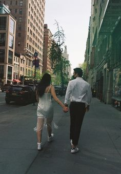 #newyorkcitycouple #newyorkelopement #urbanelopement #elopenewyork #elopenewyorkcity #newyorkcityelopement #cityelopement #citycouple #shortweddingdress #nontraditionalweddingdress #weddingdaytennisshoes #filmcamera #filmphotos