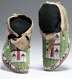 native american, America, Arapaho beaded hide moccasins, sinew-sewn using bead colors of pea green, red white-heart, white, dark blue, and marcasite; triangular tongue; folded scalloped cuff, late 19th century.