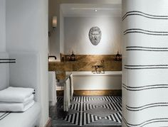 I like the thin black stripes on the wall, as well as the patterned floor. I like mixing patterns.