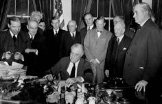 U.S. President Franklin D. Roosevelt signs the declaration of war at the White House in Washington, D.C., December 8, 1941 at 3:08 p.m (Photo by Associated Press)