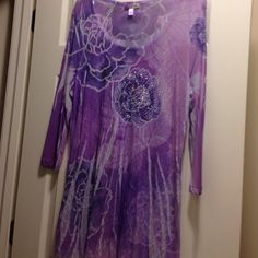 Dress Barn Women's Stretch Lace Blouse Pretty and feminine!  Size XL. Shades of purple lace.  3/4 sleeves.  Blouse flares at bottom.  Center has glittery purple and silver floral embellishment!.  Like new!  Pretty with skinny jeans or leggings!                                                     Smoke-free household. Dress Barn Tops Blouses