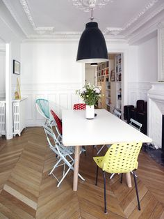 Whats not to love, black pendant, white walls and pastel chairs....ahhhh