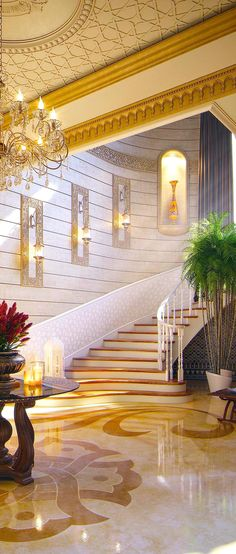 GORGEOUS ENTRYWAY | Just Gorgeous, with gold details! | bocadolobo.com/ #modernentryway #entrywayideas
