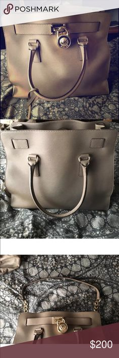 Michael Kors Handbag In close to perfect condition. May be very small imperfections on the inside of the bag (ex. small pen marks) but nothing on the outside. Absolutely beautiful bag! Michael Kors Bags Satchels