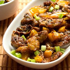 A Spicy Indo Chinese Recipe of Mushroom Manchurian. Batter coated deep fried Mushrooms later stir fried with veggies.