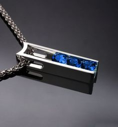 Argentium silver and Chatham blue sapphire pendant designed by David Worcester for VerbenaPlaceJewelry.Etsy.com