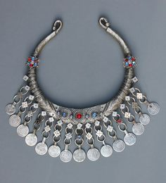 A Swat, Pakistan torque. From the Pashtun people. With many Afghan coins from the in silver. The body of the torque in similar alloy. With incredible engraving and many symbolic designs. Mid century, over 600 grams. Tribal Jewelry, Beaded Jewelry, Silver Jewelry, Ancient Jewelry, Antique Jewelry, Turkish Jewelry, Other Accessories, Pakistan, Jewelery