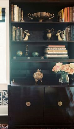 Love the power of a dark wall and cabinetry to create sophisticated backdrops for collections....onny-mar-april2011