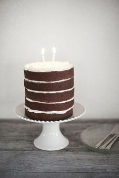 A Subtle Revelry . simple chocolate layer cake . { love the simplicity of this . great chocolate cake recipe . would look lovely with simple celebratory bunting . & . maybe a tiny few sprinkles } .