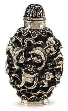 Chinese silver snuff bottle   Modelled in relief with fu lions between lingzhi head bands to shoulder and base, raised on flat footring, with conforming fu-bat design cap.