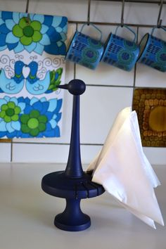 white kitchen tiles with tobacco brown - and blue! Blue Wooden Napkin Holder Bird / Paavo by Scandinaviavandesign