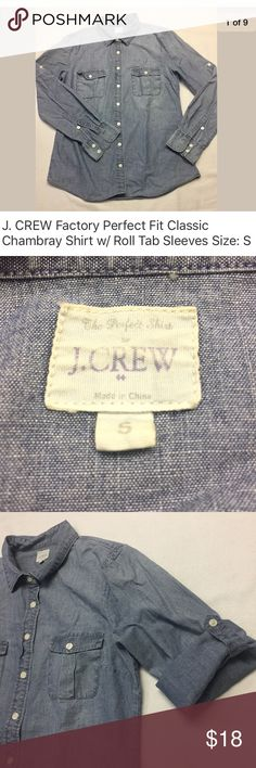 """J. Crew Factory Perfect Fit Classic Chambray Shirt J. Crew Factory, Perfect Fit Classic Chambray Shirt in Blue with roll tab sleeves. Excellent pre-owned condition- NO rips, holes, stains or missing. buttons. Laundered, clean and ready to ship.  Size on tag: S Measures approximately: 18"""" from armpit to armpit 23"""" from shoulder to cuff 25.5"""" length  Product Details Cotton. Long roll-up sleeves. Functional buttons at cuffs. Chest pockets. J. Crew Tops Button Down Shirts"""