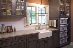 """Beautiful laundry room. Loving the etched detail on the sink and """"purple"""" cabinetry!"""
