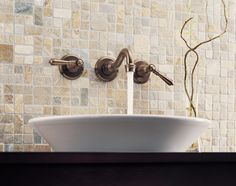 Wall mounted faucet on tile backsplash