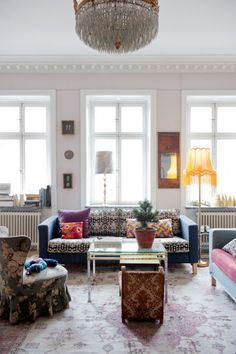 Colorful Swedish Style. I love that the cushions have been redone with a pattern.