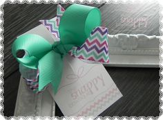 Perfect for ponytails and pigtails, these gorgeous no-slip hair bows are sure to make your little girl's eyes widen with delight! Twisted Boutique Bows are made up of two beautiful coordinating ribbon prints that have come together for one amazing bow!