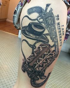 Pistol, cowboy hat and cowboy boots tattoo