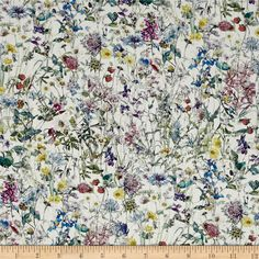 Liberty of London Wild Flowers Lawn White/Lavender from @fabricdotcom  From the world famous Liberty Of London, this exquisite cotton lawn fabric is finely woven, silky, very lightweight and ultra soft. This gorgeous fabric is oh so perfect for flirty blouses, dresses, lingerie, even quilting. Colors include white, shades of green, shades of blue, yellow, pink, purple, and brown.