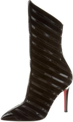 Black suede and patent leather Christian Louboutin Gouzimine ankle boots with pointed toes, tonal stitching, covered heels and zip closures at counters.
