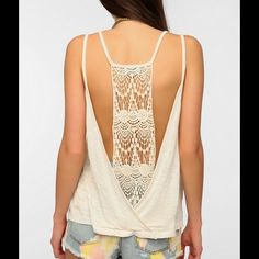 Shop Women's Urban Outfitters White Cream size S Tank Tops at a discounted price at Poshmark. Description: Beautiful open back loose fit slub knit tank from Staring at Stars. Back features a beautiful crochet panel and an open back style. Would look great with a lace bralette. Perfect for this hot summer days! Excellent condition. Size Small.. Sold by freethetoast. Fast delivery, full service customer support.